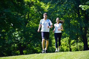 A young couple jogging at Edith Morley Parkpark in Campbell, California.