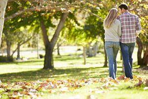 A couple taking a romantic stroll in Wildwood Park in Saratoga, California.